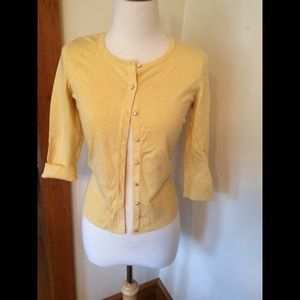 Pale yellow cardigan with metallic buttons